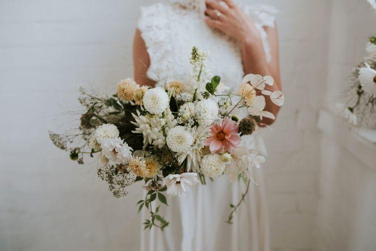 delicate wedding bouquet with white dahlias, stocks and foliage