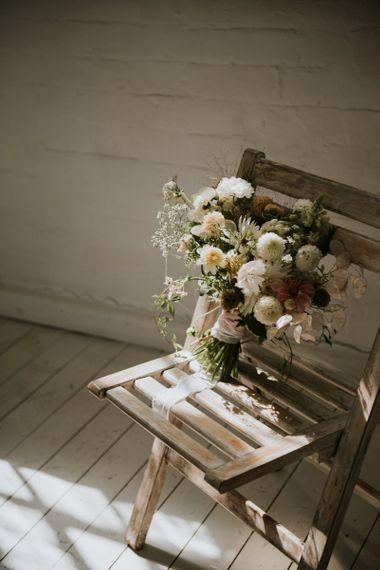 Wedding bouquet sitting on a chair for minimalism wedding