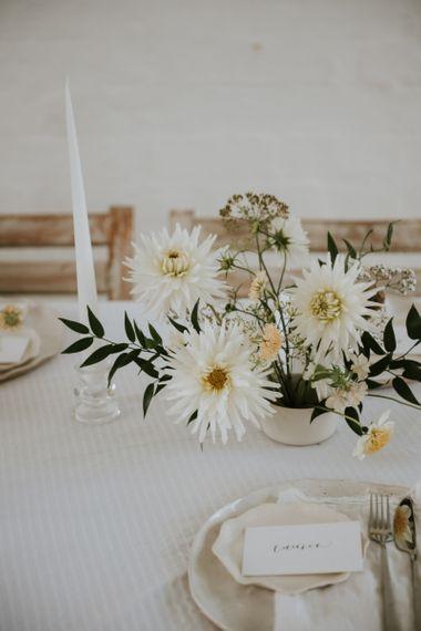 White, lemon and green delicate wedding flower centrepiece for minimalism wedding