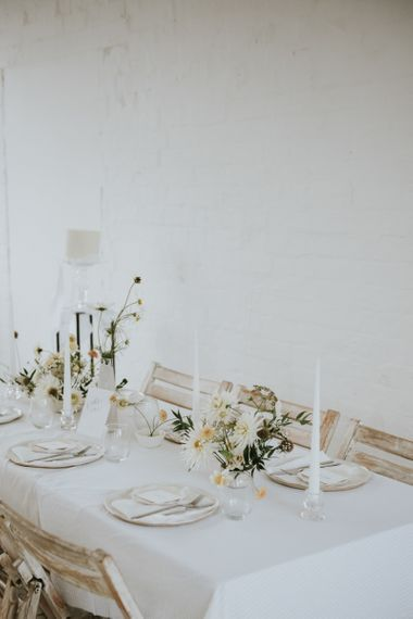 minimalist table decor with taper candles and delicate flowers