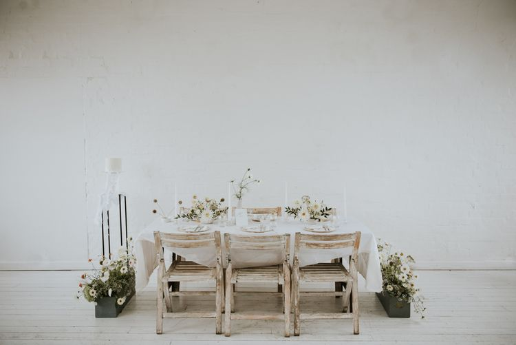 minimalist tablescape with white wash chairs and tables
