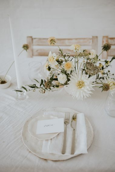 place setting with charger plate and floral centrepiece