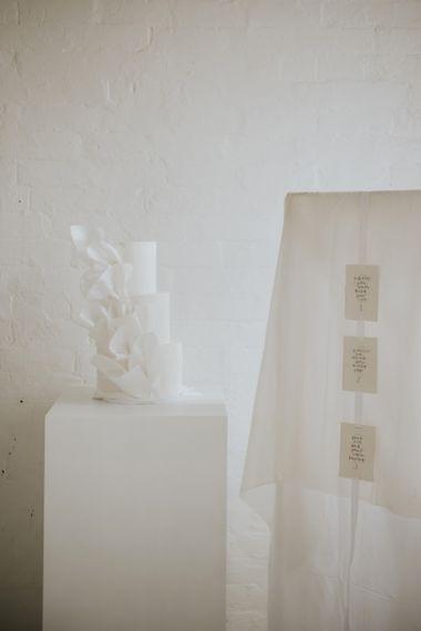White wedding cake with ruffle design for minimalism wedding inspiration