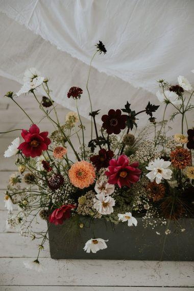 Deep red, orange and white wedding flower stems wedding decor