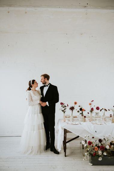 Stylish bride and groom at minimalism wedding