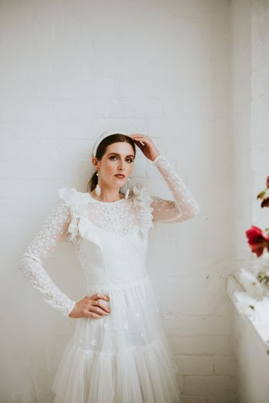 Lace wedding dress with ruffles and long sleeves