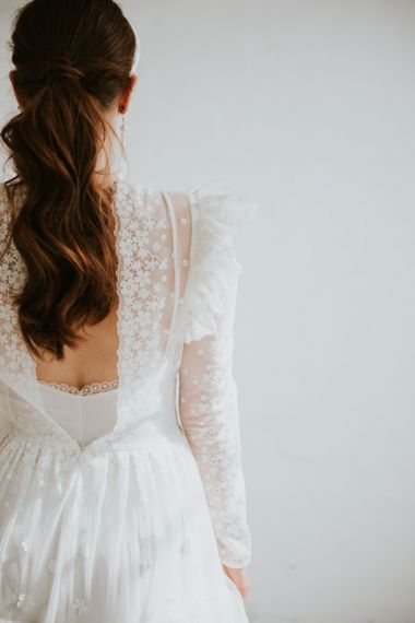 delicate lace wedding dress with low back detail