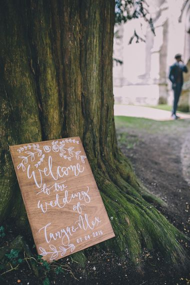 Wooden Welcome Sign For Wedding // Rue De Seine Bride With Flower Crown For Magical Tipi Wedding In Wiltshire With Images By Story + Colour Photography