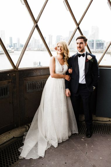 Laced Ted Baker wedding dress with v-neck and sheer overskirt