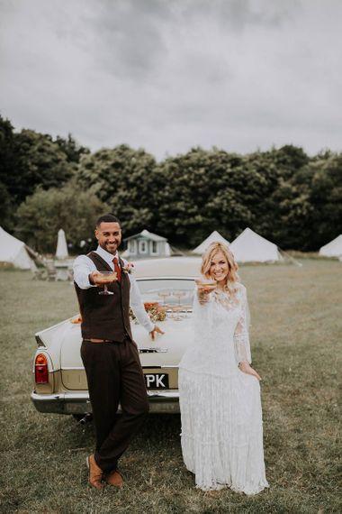 Boho Bride and Groom Celebrating at Wilderness Weddings Venue
