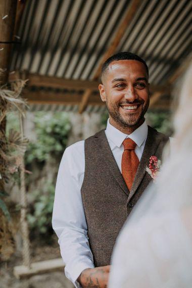 Groom in Brown Wool Waistcoat and Orange Tie