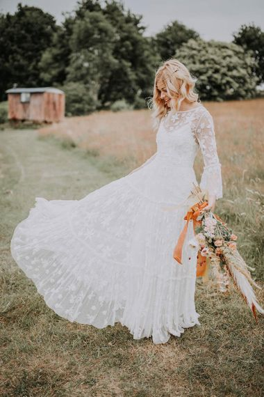 Boho Bride in Lace Wedding Dress with Long Sleeves
