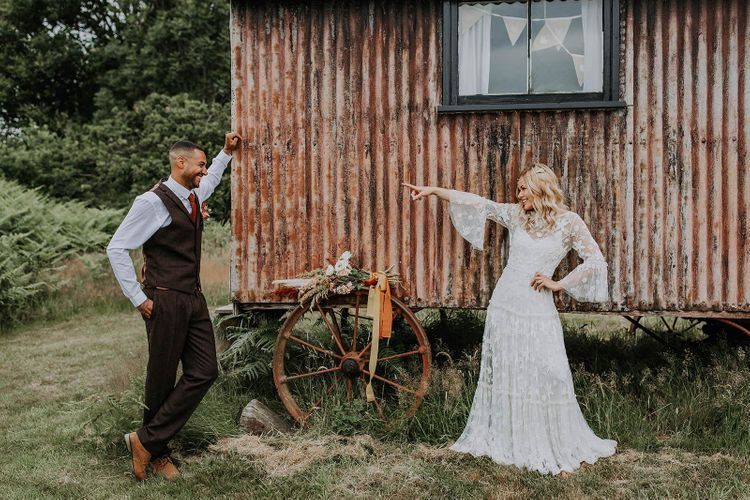 Bride and Groom Posing by a Corrugated Iron Shed
