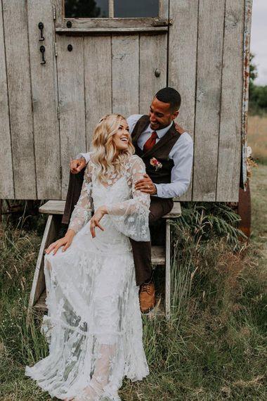 Boho Bride and Groom Sitting on a Shed Steps