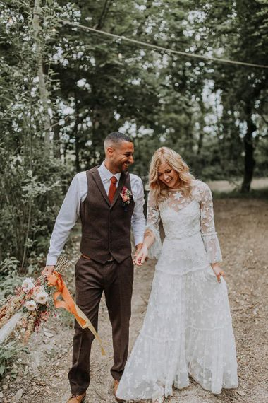 Boho Bride and Groom Holding Hands in the Woodland