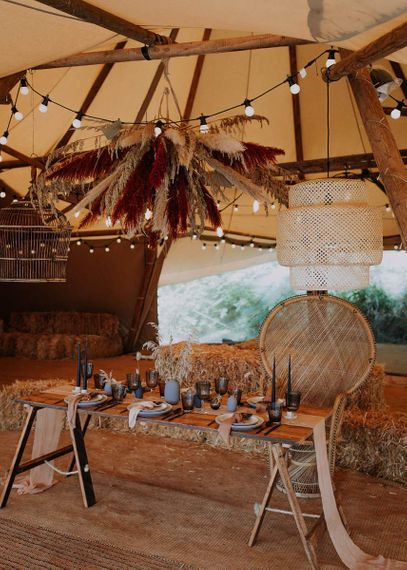 Tipi Reception Table with Wicker Peacock Chair and Pampas Grass Installation