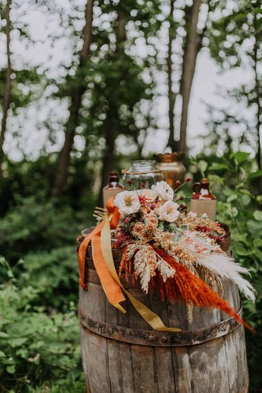 Orange and Neutral Flower Wedding Bouquet Tied With Ribbons