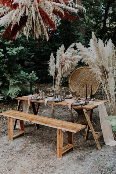 Outdoor Tablescape with Wooden Bench, Peacock Chair and Pampas Grass Flowers