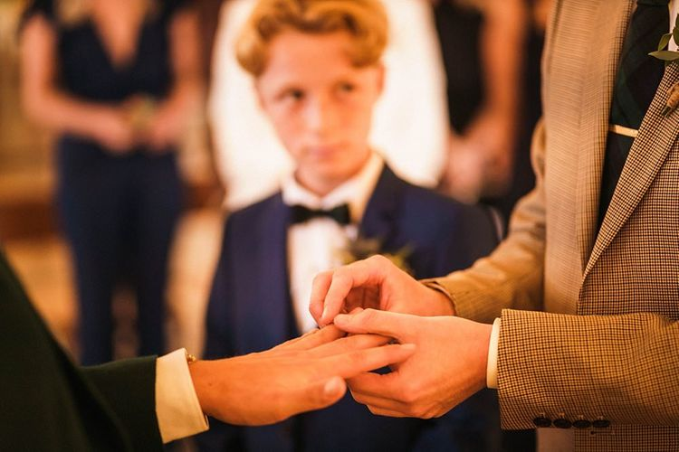 Grooms exchange rings at  Trinity Buoy Wharf wedding