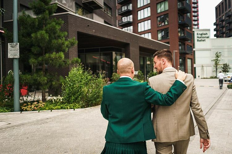 Groom in green wedding suit with his new husband