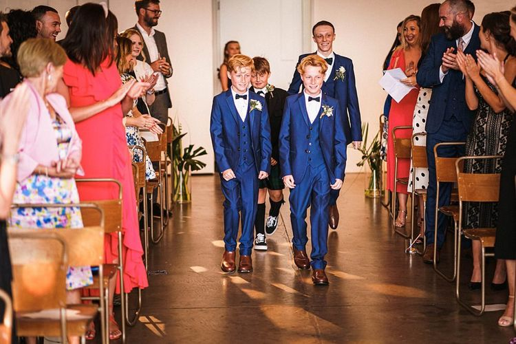 Page boys walk down the aisle at  Trinity Buoy Wharf