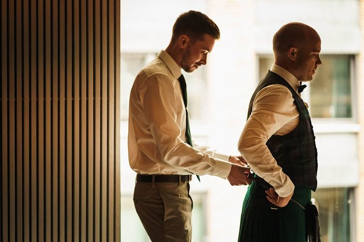 Grooms get ready for Trinity Buoy Wharf wedding