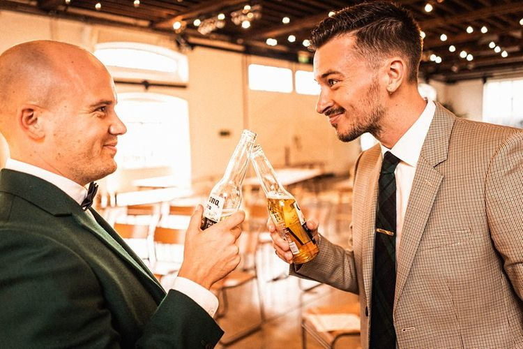 Grooms toast their wedding at  Trinity Buoy Wharf