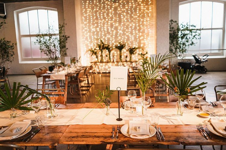 Wedding table decor with palm leaf decor