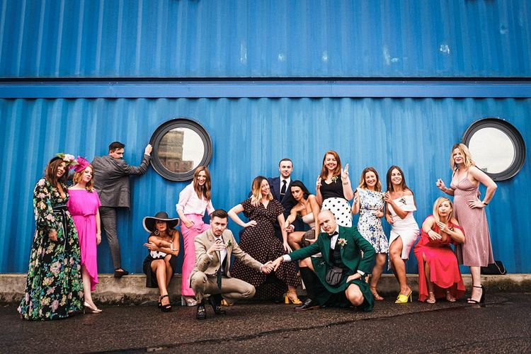 Grooms pose with guests at  Trinity Buoy Wharf wedding