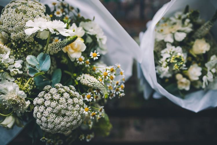 White floral bouquets for same-sex wedding in London with vintage styling and colourful decor