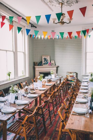 Colourfully styled reception with vintage decor and bunting for intimate city celebration