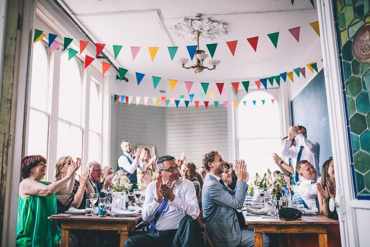 The Roost Dalston intimate wedding reception with vintage decor and colourful bunting