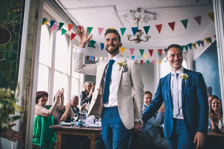 The Roost Dalston same-sex wedding reception with vintage decor and colourful bunting