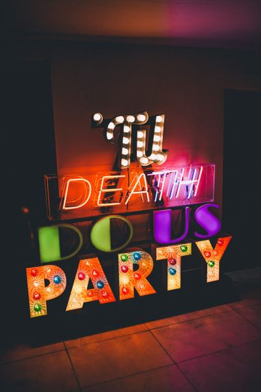 'Til death do us party colourful sign at colourful reception with vintage styling