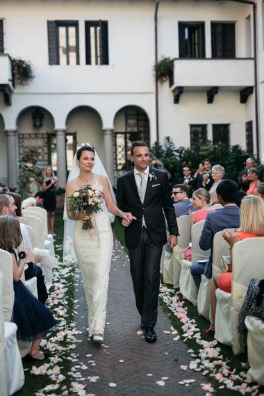 Wedding Ceremony | Bridal Entrance  in Nora Sarman Gown & Jimmy Choo Shoes | Elegant Blush Pink & White Destination Wedding at Hotel La Palma, Stresa Italy, Planned by Princess Wedding | Berni Photography