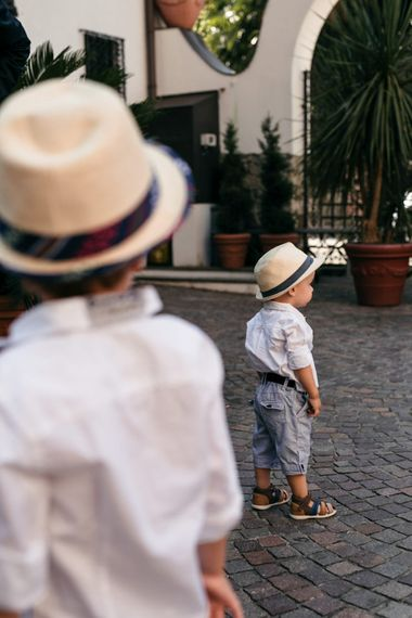Adorable Page Boys in Shorts, and Panama Hat | Elegant Blush Pink & White Destination Wedding at Hotel La Palma, Stresa Italy, Planned by Princess Wedding | Berni Photography