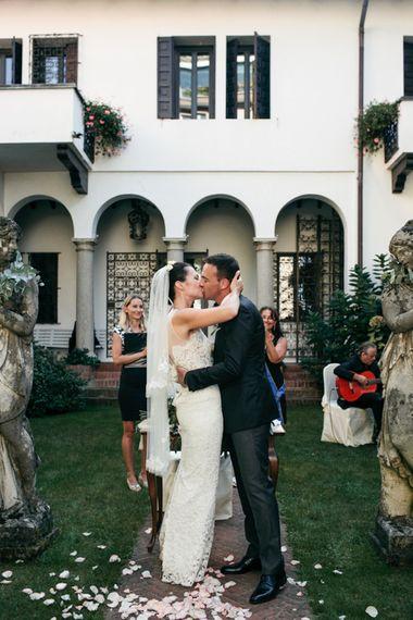 Outdoor Wedding Ceremony | Bride in Nora Sarman Gown & Jimmy Choo Shoes | Groom in Corneliani Suit | Elegant Blush Pink & White Destination Wedding at Hotel La Palma, Stresa Italy, Planned by Princess Wedding | Berni Photography