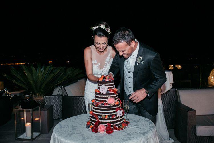 Cutting the Cake | Bride in Nora Sarman Gown & Jimmy Choo Shoes | Groom in Corneliani Suit | Elegant Blush Pink & White Destination Wedding at Hotel La Palma, Stresa Italy, Planned by Princess Wedding | Berni Photography