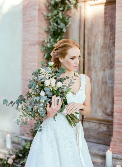Bride in Lace Sorrisi di Gioia Wedding Dress Holding in a Eucalyptus  & Pink Rose Bouquet