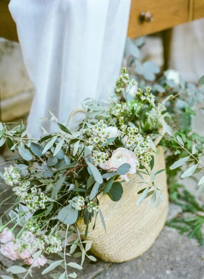 Straw Bag with Eucalyptus, Foliage and Pink Flowers