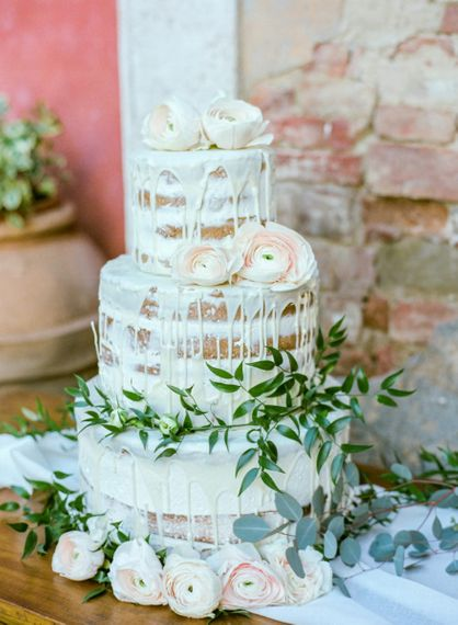 Semi Naked Wedding Cake with Drip Icing Decorated with  Foliage and Flowers