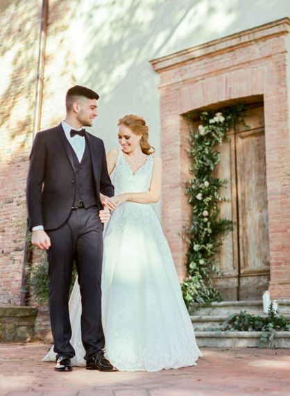 Bride in Lace Sorrisi di Gioia Wedding Dress and Groom in Black Tie Suit