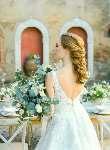 Bride in Lace Sorrisi di Gioia Wedding Dress with V Back and Braided Hairstyle