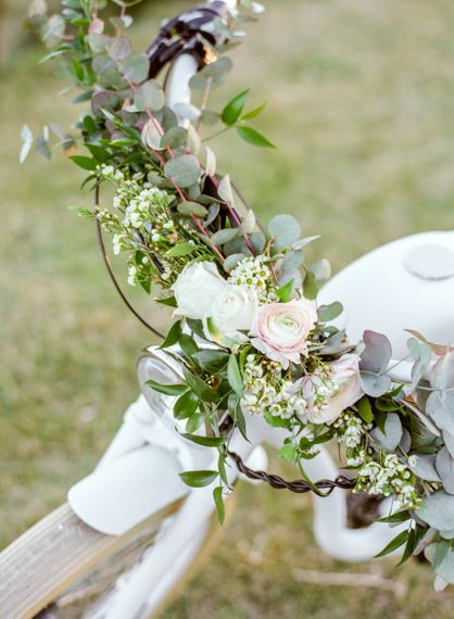 Romantic Wedding Flowers Decorating the Handle Bars of the Vintage Bicycle