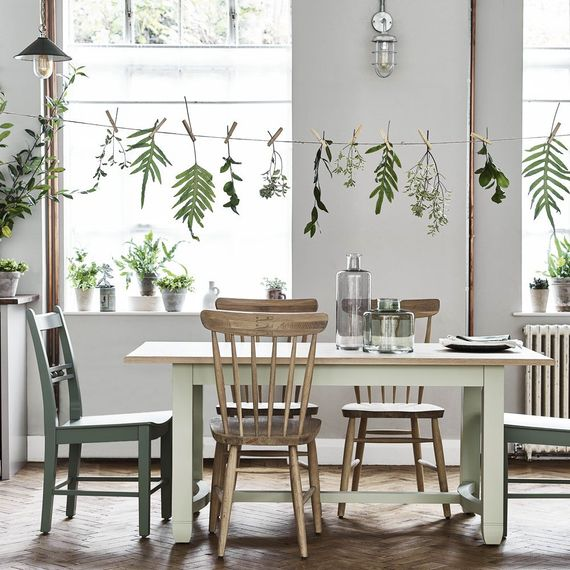 Dining Table with Mis-Match Chairs & Hanging Leaves Decor