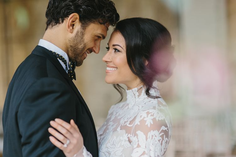 Bride in Lace Long Sleeved Suzanne Neville Wedding Dress | Groom in Traditional Morning Suit | Blush & Burgundy Floral Fairytale Wedding Inspiration at Grittleton House Planned & Styled by Jennifer Louise Weddings | Katherine Yiannaki Photography