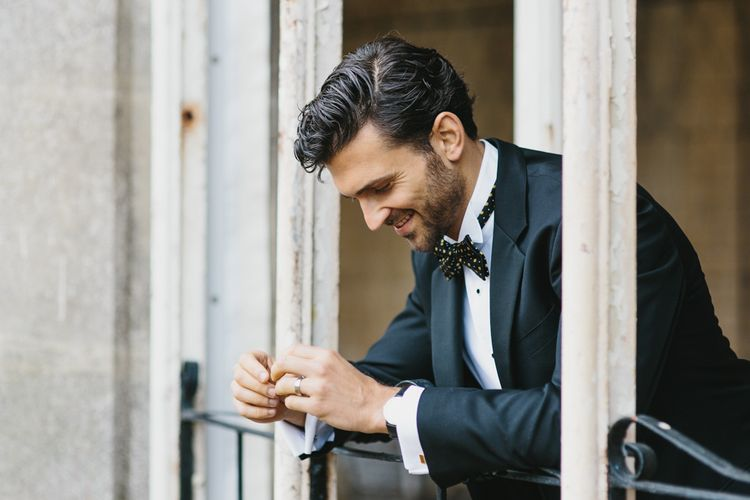 Groom Walters of Oxford Suit with Bow Tie | Blush & Burgundy Floral Fairytale Wedding Inspiration at Grittleton House Planned & Styled by Jennifer Louise Weddings | Katherine Yiannaki Photography