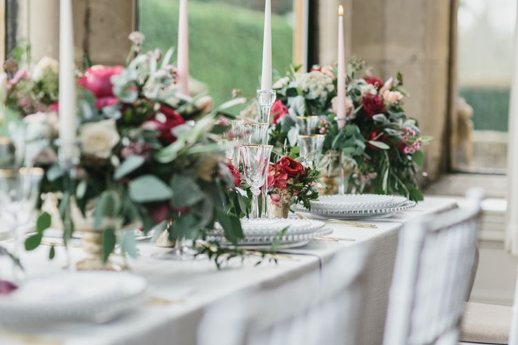 Reception Table Decor with Taper Candles & Low Floral Arrangements | Blush & Burgundy Floral Fairytale Wedding Inspiration at Grittleton House Planned & Styled by Jennifer Louise Weddings | Katherine Yiannaki Photography