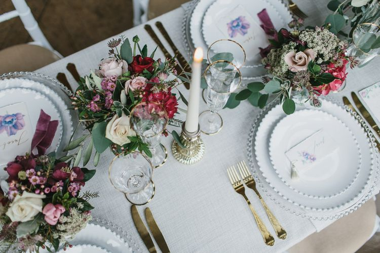 Reception Table Place Settings with Tableware by Duchess & Butler | Blush & Burgundy Floral Fairytale Wedding Inspiration at Grittleton House Planned & Styled by Jennifer Louise Weddings | Katherine Yiannaki Photography