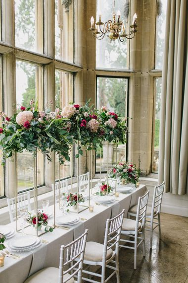 Reception Table Decor with Taper Candles & High Floral Arrangements | Blush & Burgundy Floral Fairytale Wedding Inspiration at Grittleton House Planned & Styled by Jennifer Louise Weddings | Katherine Yiannaki Photography